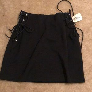 Mini skirt with lace up sides size small
